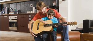 Kid-playing-guitar